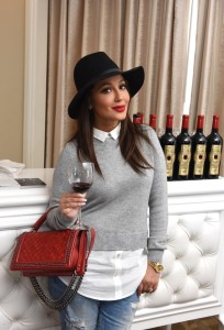 Adrienne Bailon was in great spirits as she sipped on Un Joyau Majestueux Ruby (2014) Cabernet Sauvignon from Napa Valley